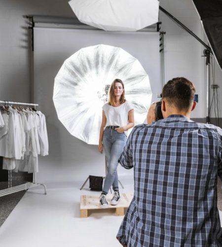 man-taking-photo-woman-model-studio_23-2148532621