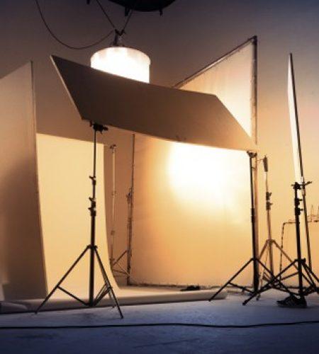 shooting-studio-photographer-creative-art-director-with-production-crew-team-setting-up-lighting-flash-led-headlight-tripod-professional-equipment-portrait-model-photo-shoot_258335-51
